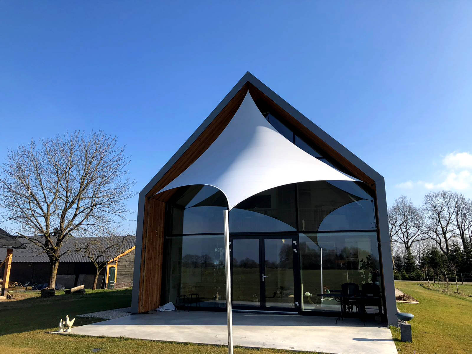 Revolutionize your outdoor living with our textile patio roofing solution